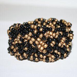 Wide black and gold cuff bracelet